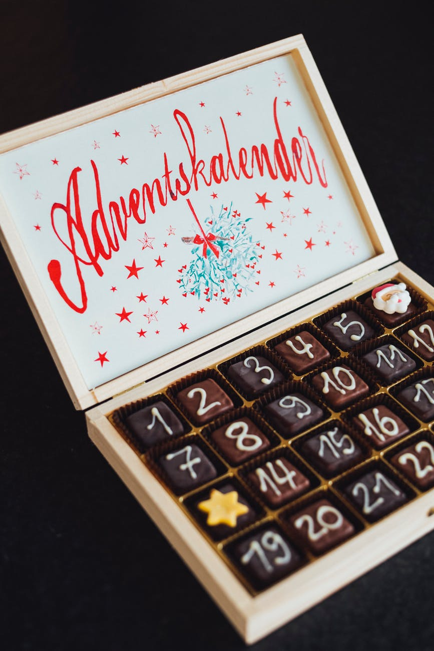 chocolates on white wooden box
