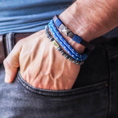 Photo showing a mans wrist with several of the Bracelets Together options